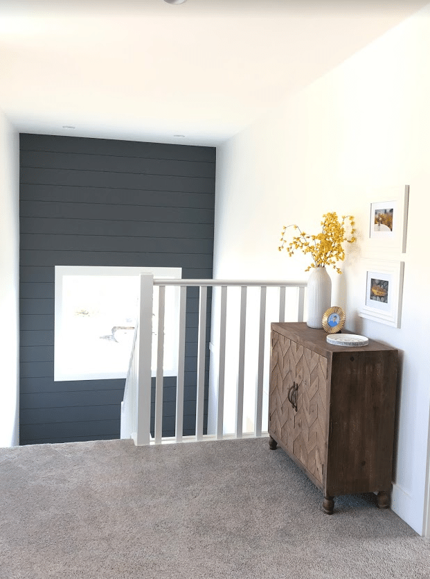 Landing of staircase, shiplap feature wall, Sherwin Web Gray and Pure White, warm gray carpeted stairs. Kylie M Interiors Edesign, online paint color consultant, diy decorating ideas