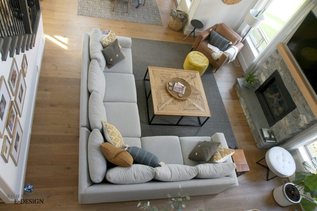 Living room furniture layout, sectional, square wood coffee table, brown leather accent chair, white oak flooring. stone fireplace. Kylie M INteriors Edesign, online paint color