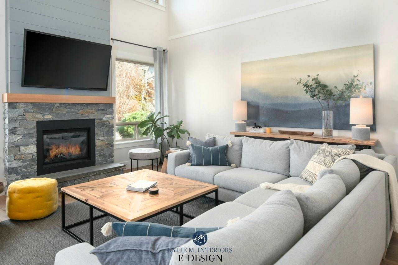 Living room vaulted ceiling stone and shiplap fireplace with TV off white greige walls decor in grays greens and blues Kylie M Interiors Edesign online paint colour