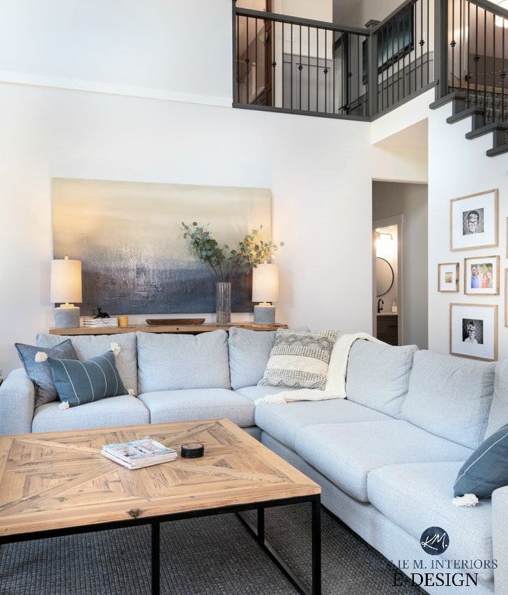 DIY decorating and design ideas. Living room with open stairwell. Large gray sectional, rustic wood coffee table and sofa table, home decor, off-white greige paint color. Kylie M INteriors Edesign, online paint color consulting