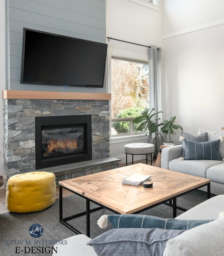 Livingroom vaulted ceiling, stone and shiplap fireplace with TV, off-white greige walls decor in grays, greens and blues. Kylie M Interiors Edesign, online paint colour. Diy decorating and design blog and ideas