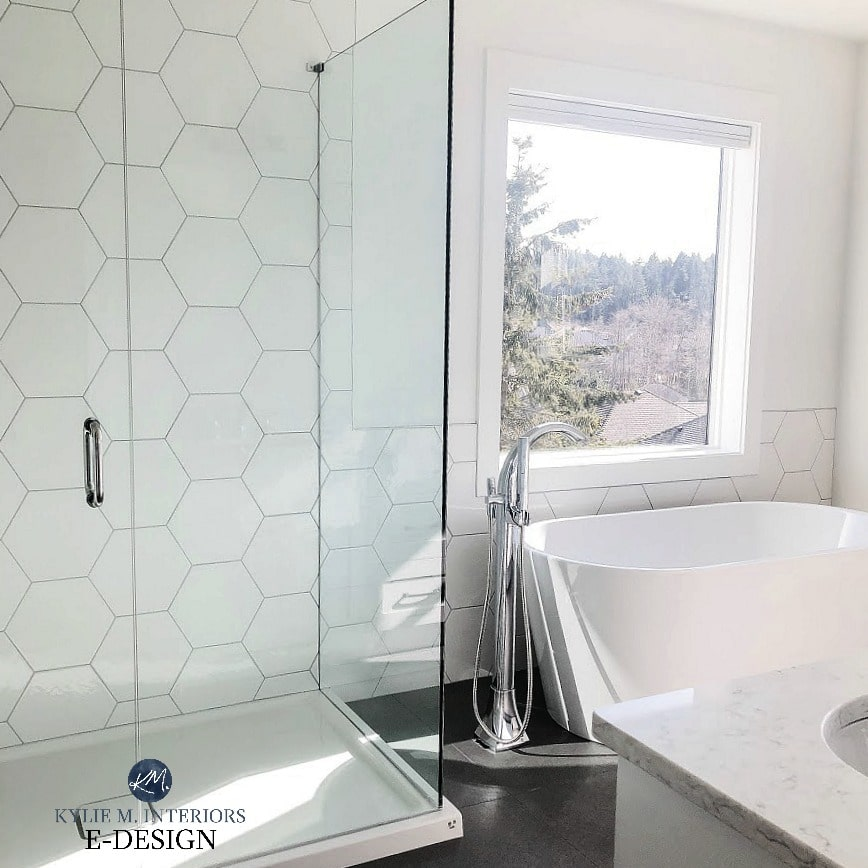 Master bathroom, white hexagon tile shower walls, fibreglass floor, LG quartz countertop, Pure white walls, freestanding tub. Kylie M INteriors Edesign,