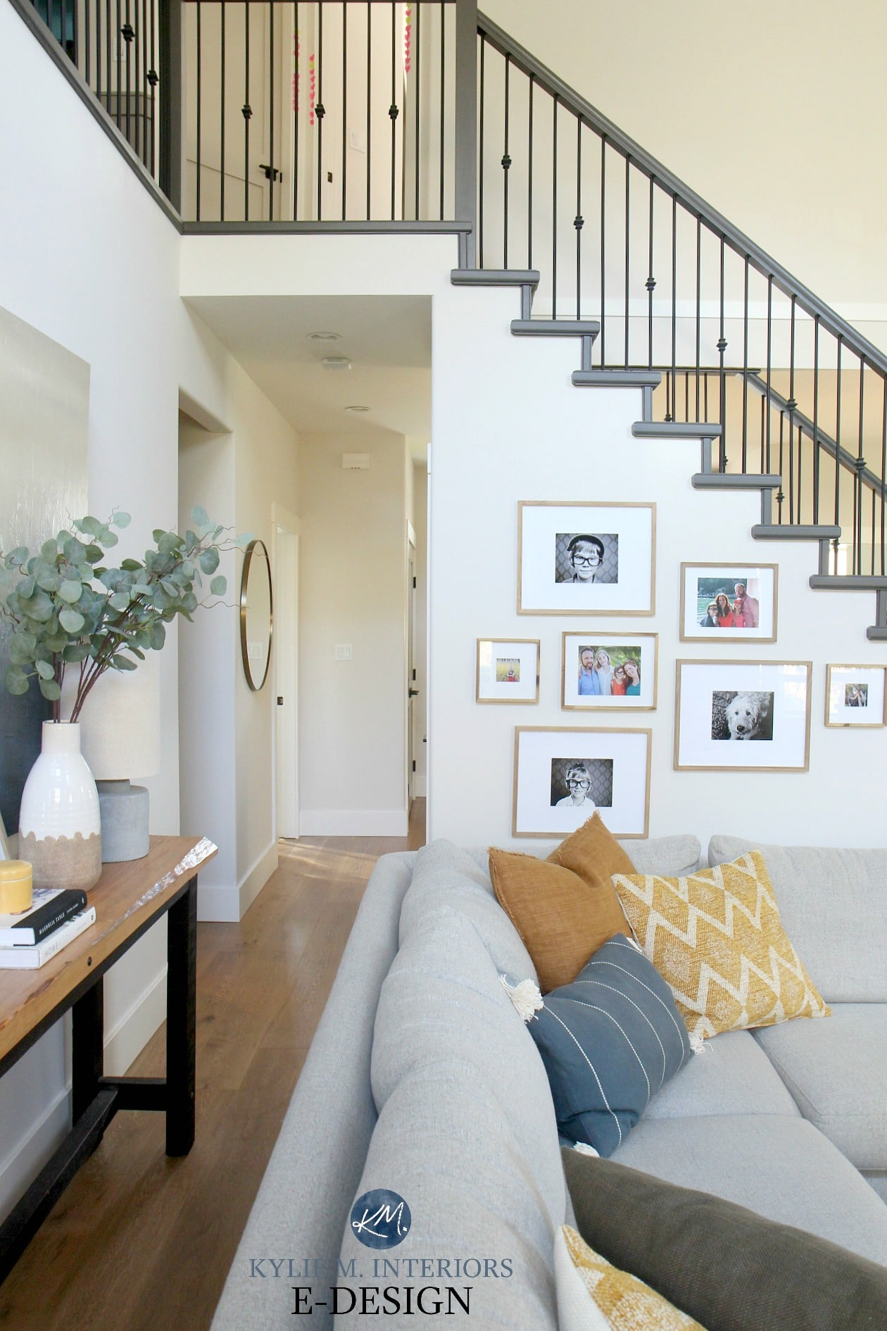 Open layout, livingroom, tall ceiling, vaulted, Benjamin Moore Edgecomb Gray best greige and White Dove. Sherwin Urbane Bronze painted stair railing and open staircase. DIY Decorating and Design ideas