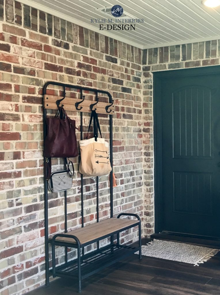 Exposed brick wall in entryway area with black door and wood flooring. Kylie M Interiors Edesign, consultant for best paint colours from Benjamin Moore and Sherwin online