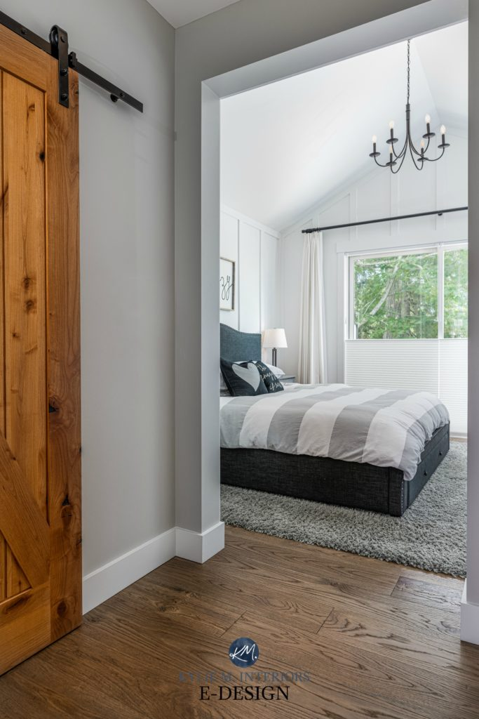 Master Bedroom, white board and batten paint colour, vaulted ceiling, chandelier, wood barn door and white oak flooring. Stonington Gray. Kylie M Interiors Edesign, online paint color advice blog