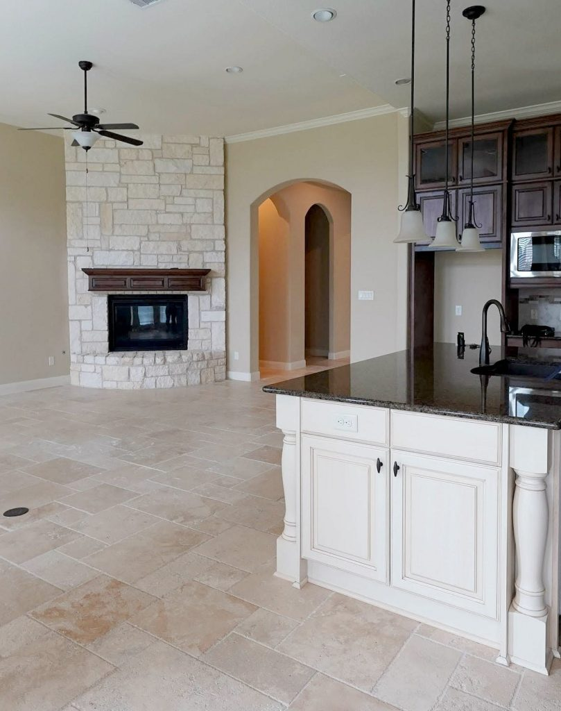 Sherwin Williams Antique White with traavertine floor and beige walls and stone fireplace. Kylie M INteriors Edesign, online paint color consultant