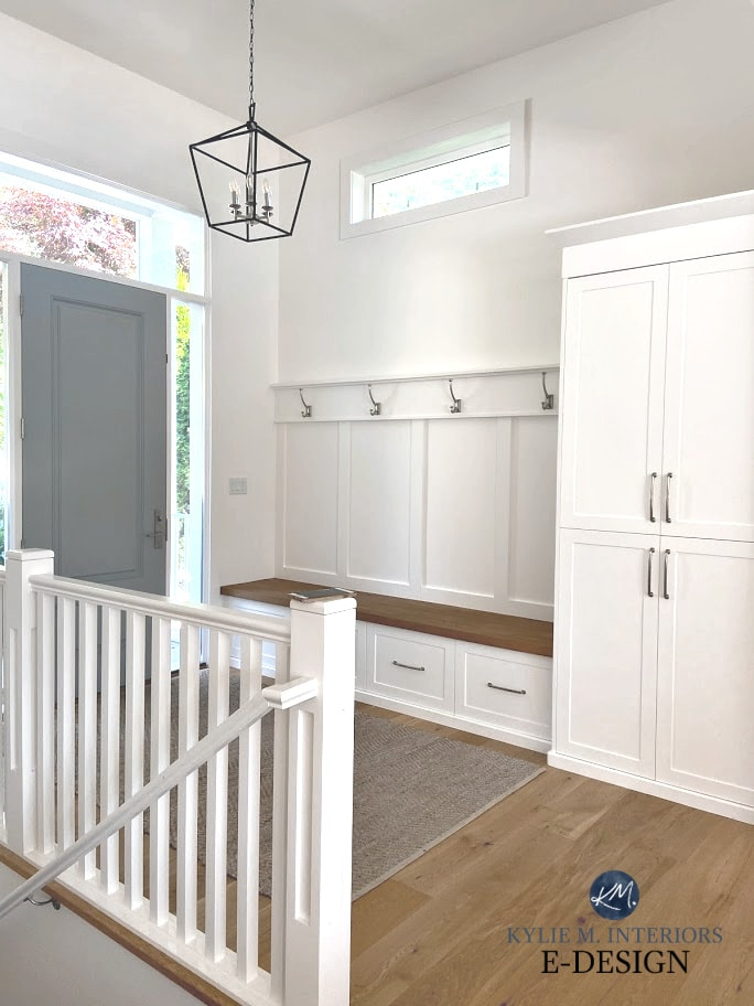 Best white paint colour, Benjamin Moore Super White, foyer with Sherwin Gris front door, white oak flooring, built-in bench. Kylie M Interiors Edesign