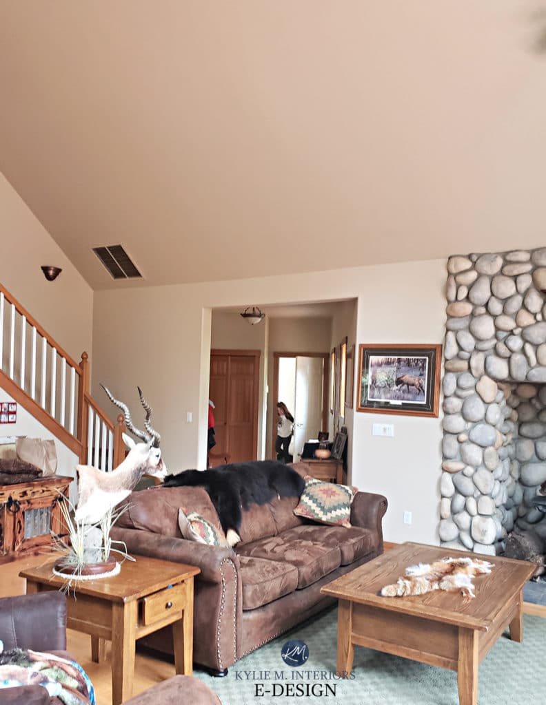 Sherwin Williams Kilim Beige, best beige paint colour, river rock stone fireplace. Hunting deer heads. Kylie M Interiors edesign