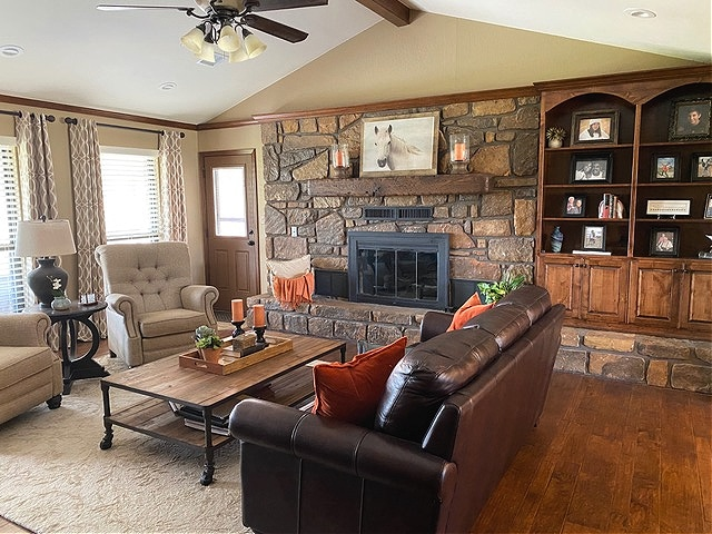 Sherwin Williams Latte, warm stone fireplace, orange accents, leather furniture. Kylie M Interiors BEFORE Edesign