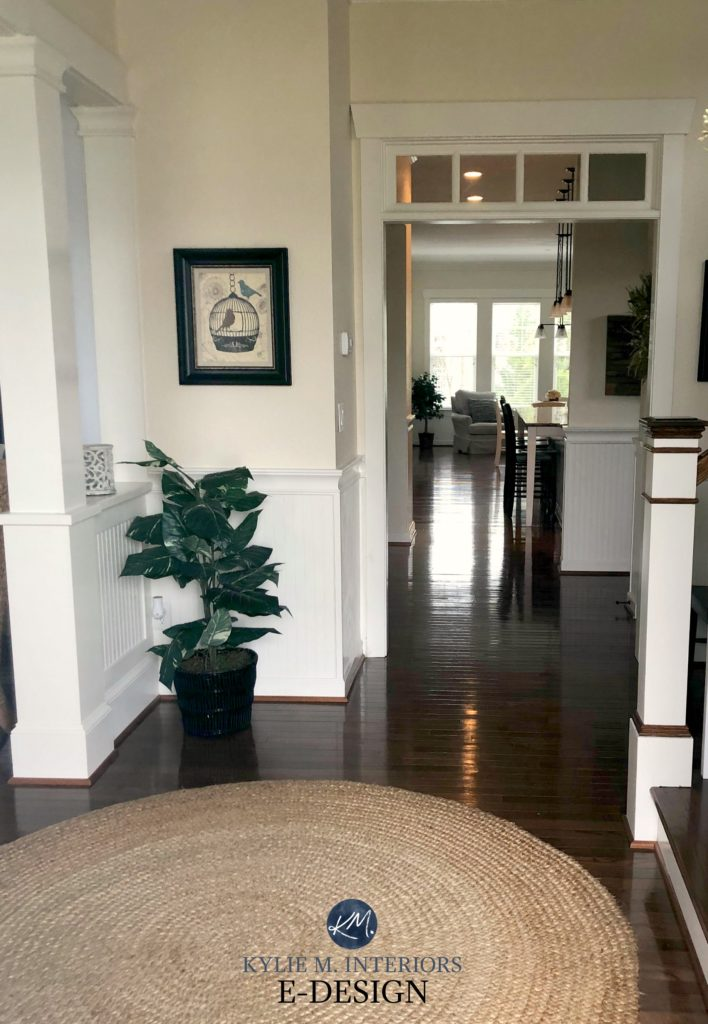 Sherwin Williams Antique White, north facing foyer, Sherwin Alabaster white wainscoting, dark wood flooring and some trim. Kylie M Interiors Edesign