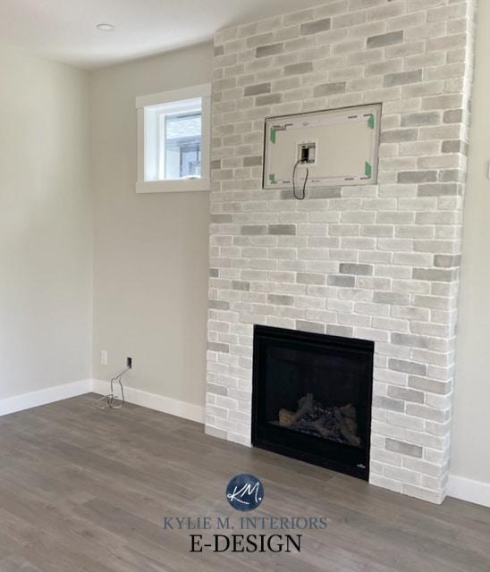 Benjamin Moore Classic Gray, off white warm gray. Brick fireplace white wash look. Gray wash laminat wood floor. Kylie M Interiors Edesign, diy blogger