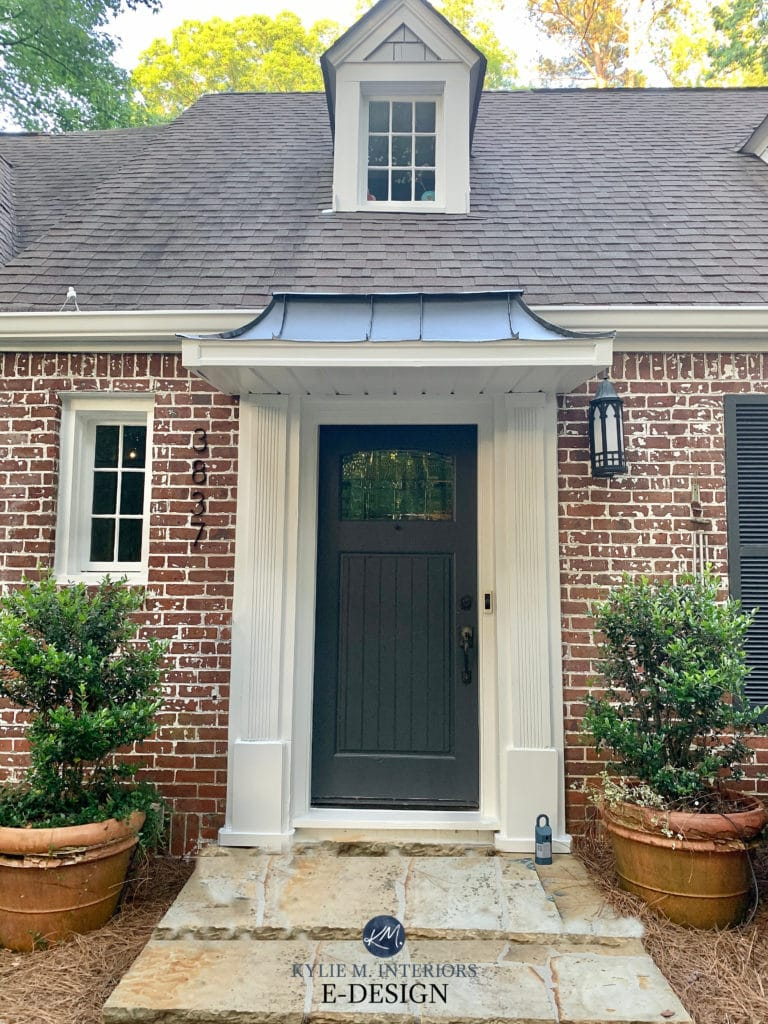 Exterior with brick and gray roof. Cheating heart painted front door, Pure White trim. Kylie M Interiors Edesign, online paint color consulting advice