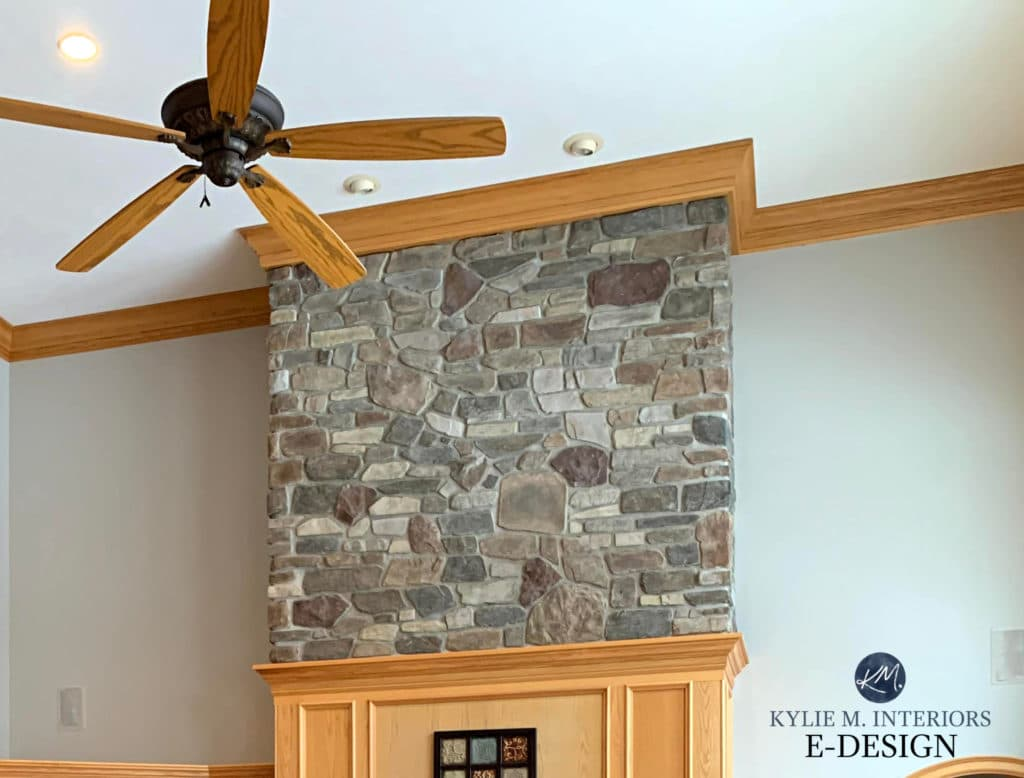 Sherwin Williams Colonnade Gray with golden oak trim and wood fireplace surround. Kylie M Interiors Edesign