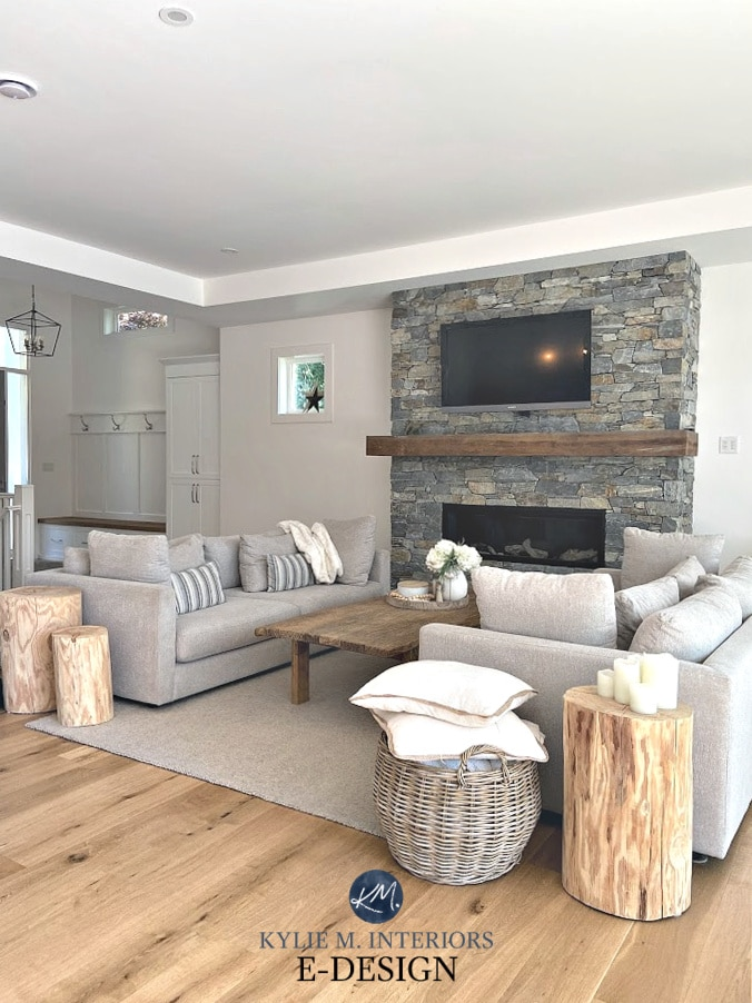 Living room in Benjamin Moore Super White, popular paint colour. Two sofas, stone fireplace, wood mantel, white oak floor. Decor. Kylie M Interiors E-design, Diy decorating blogger