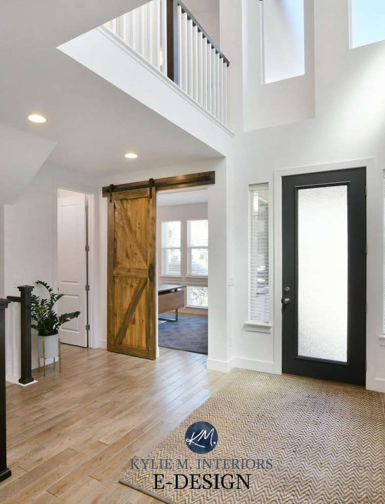 2 storey entryway or foyer, white walls, Sherwin Williams Pure White, black front door, wood stairs, sliding barn door. Kylie M Interiors Edesign, online paint colour, virtual diy decorating ideas (2)