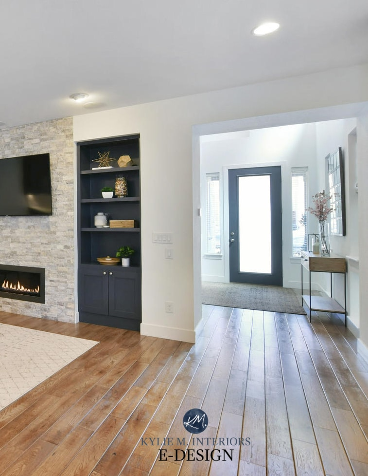 Fireplace built in painted Benjamin Moore Cheating Heart, open to foyer with black front door. Kylie M Interiors Edesign, online paint color consultant