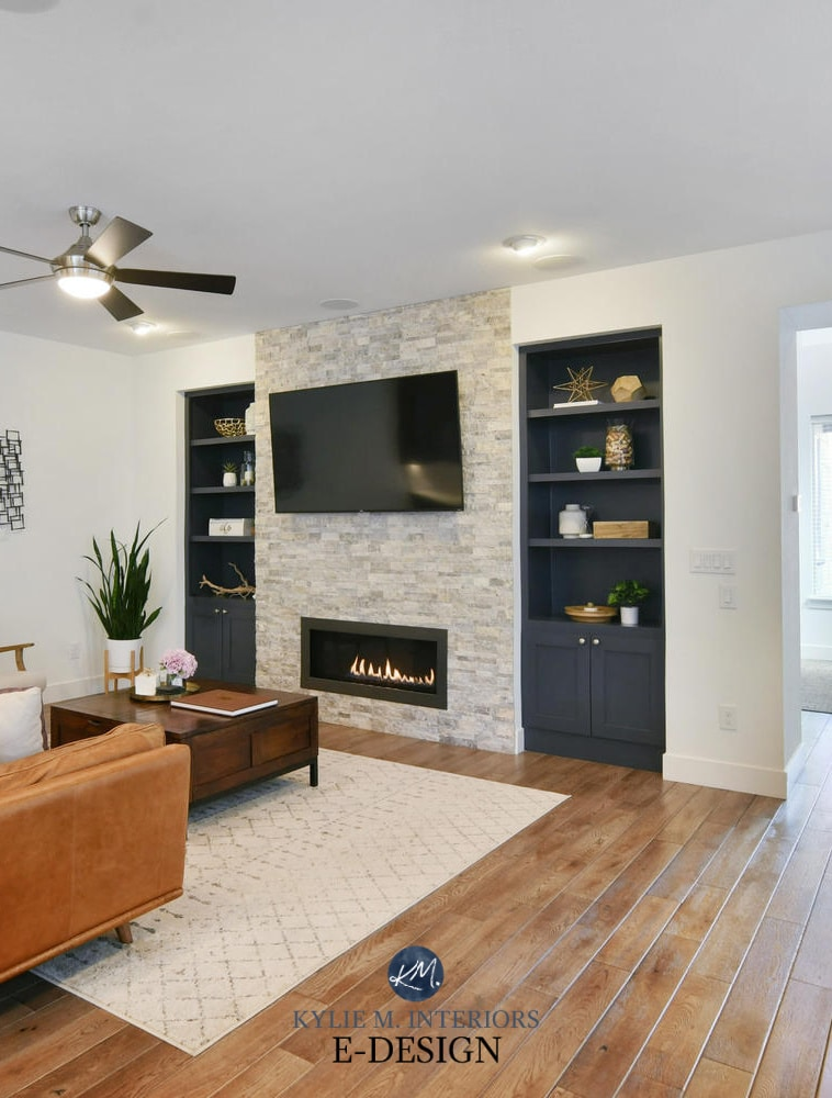 Living room, stacked stone fireplace, tv, builtins painted Benjamin Cheating Heart, Pure White walls,cognac leather. Kylie M Interiors Edesign, online paint color consultant (1)