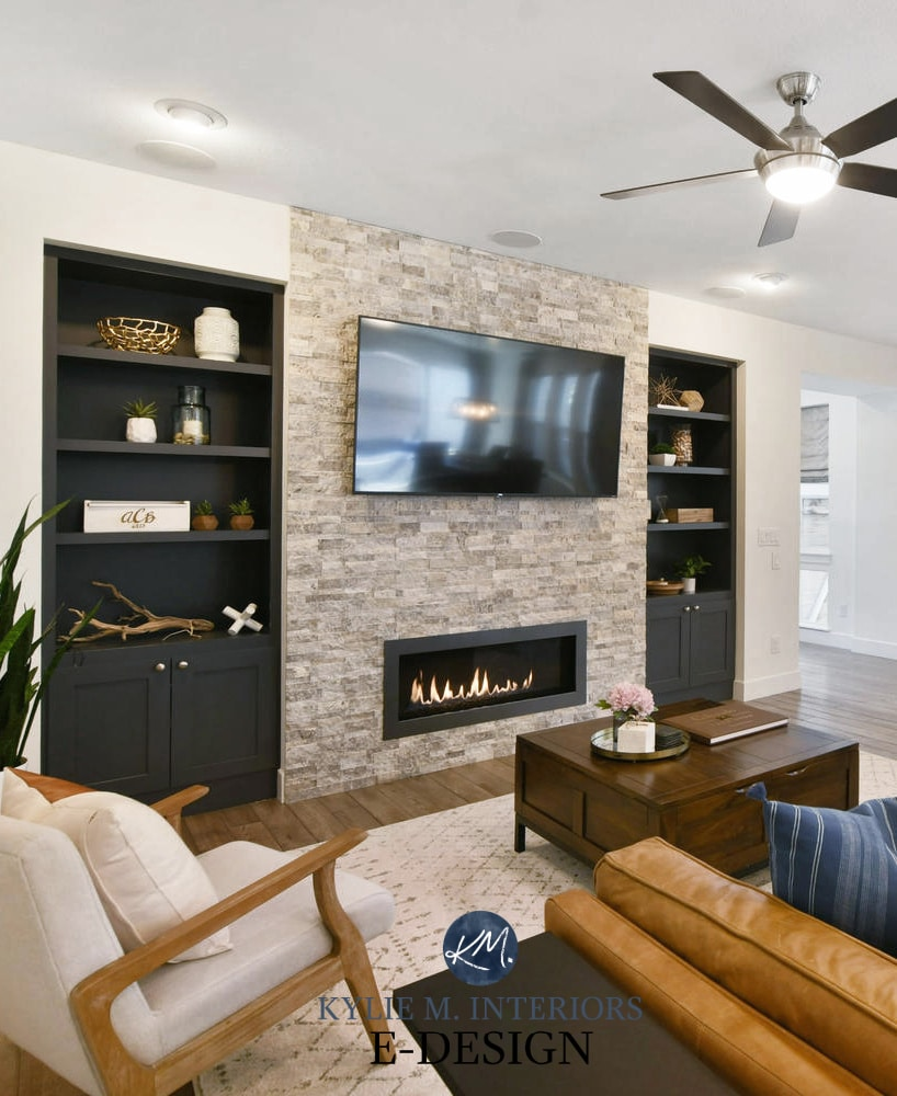 Living room, stacked stone fireplace, tv, builtins painted Benjamin Cheating Heart, Pure White walls,cognac leather. Kylie M Interiors Edesign, online paint color consultant