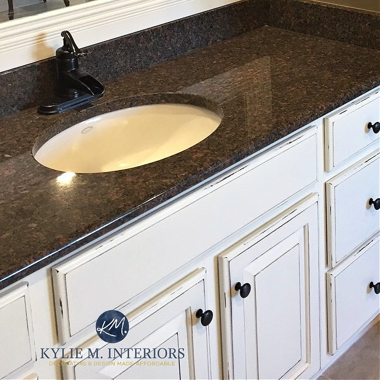 Black granite with taupe pink flecks and cream cabinet. Kylie M Interiors kitchen update modernize ideas and tips