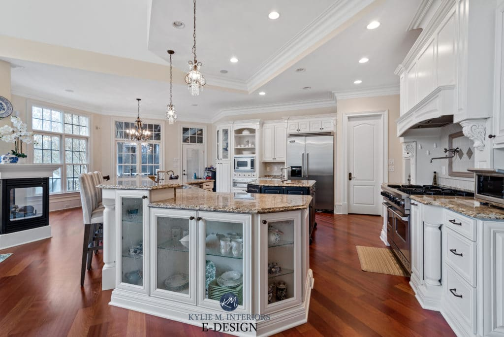 Kitchen painted maple cabinets in warm white, Sherwin Williams Alabaster, Cream beige walls, Kylie M Interiors Edesign, online color consultant. Formal, traditional style open layout kitchen