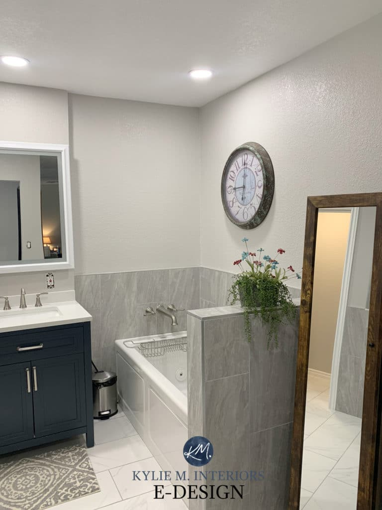 Benjamin Moore Nimbus with tile and bathtub in greige, taupe and warm gray tones. Kylie M Interiors online paint color consulting and advice blogger