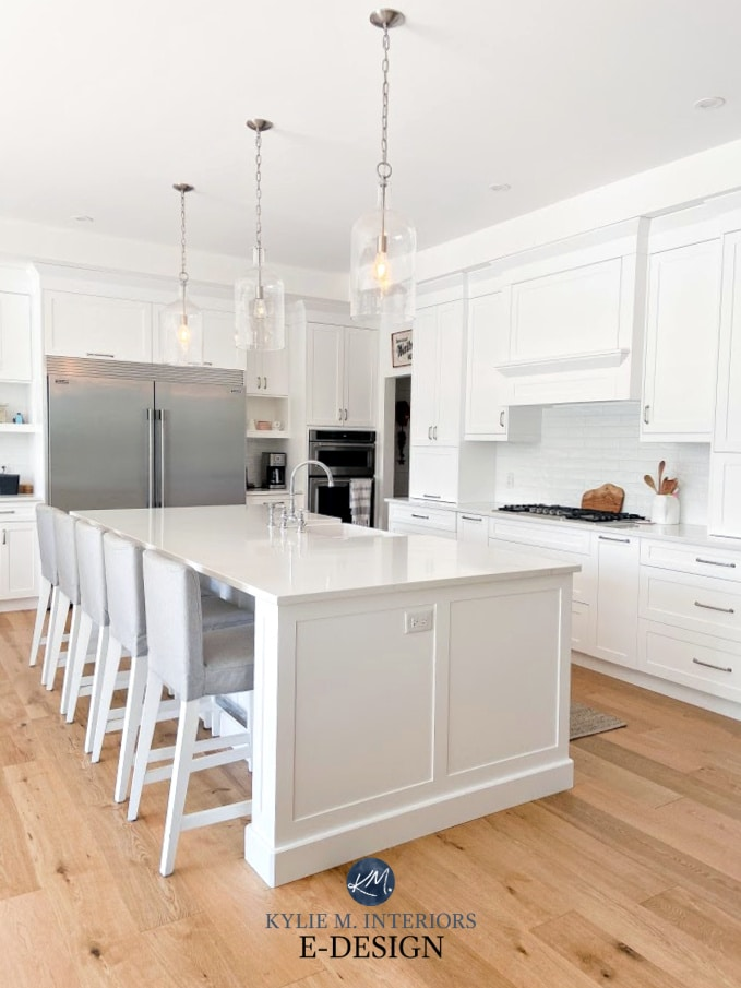 Benjamin Moore Super White match on kitchen cabinets with Silestone Calacatta Gold white quartz countertop, white oak, subway tile. Kylie M Interiors Edesign