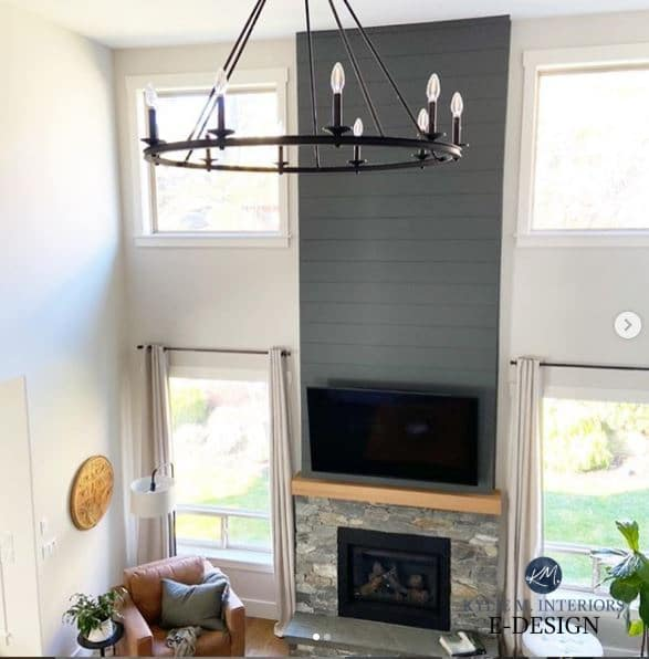 Review of Sherwin Williams Roycroft Pewter, dark gray paint colour. Fireplace with shiplap stone, round chandelier in living room. Kylie M Interiors Edesign