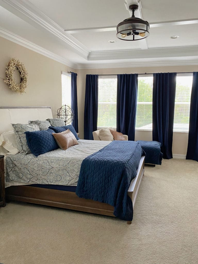 Sherwin Williams China Doll, best beige tan neutral paint color. Beige carpet, navy blue and orange accents. Kylie M Interiors online paint consulting. client photo
