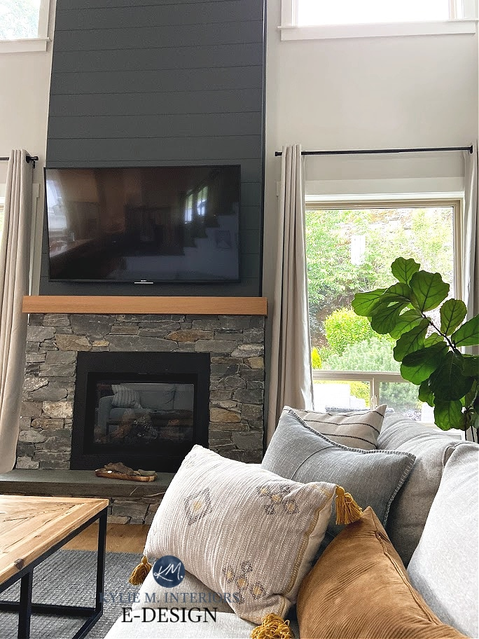 Sherwin Williams Roycroft Pewter paint color review, dark gray. Fireplace with shiplap stone, round chandelier in living room. Kylie M Interiors Edesign