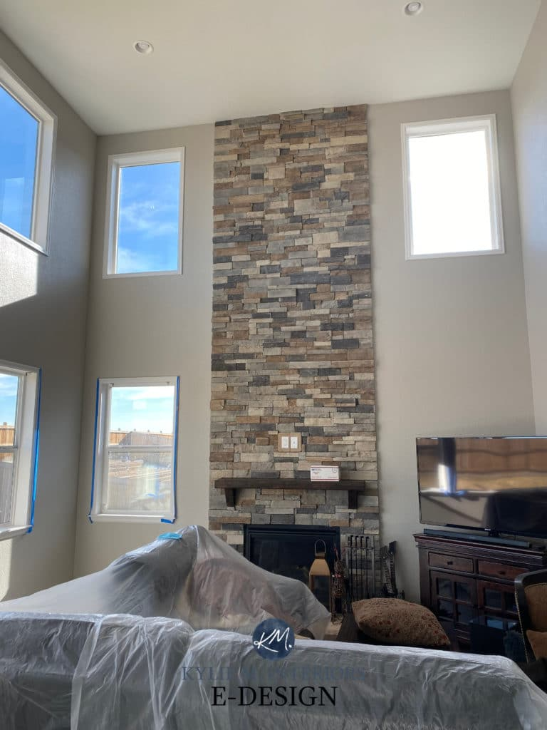 Stone fireplace, two-storey tall with Benjamin Moore London Fog, greige or taupe. Kylie M Interiors Edesign, online paint color consulting
