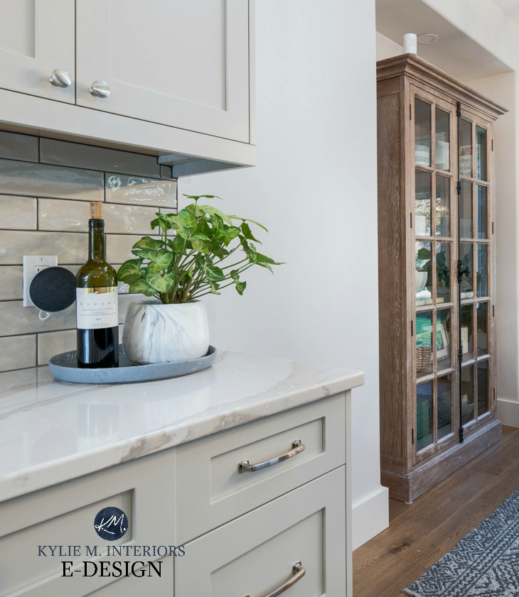 Dining room with modern farmhouse style furniture, Brittanica Warm Cambria quartz countertop, Revere Pewter warm gray cabinets. Kylie M Interiors Edesign, online paint color consulting (1)