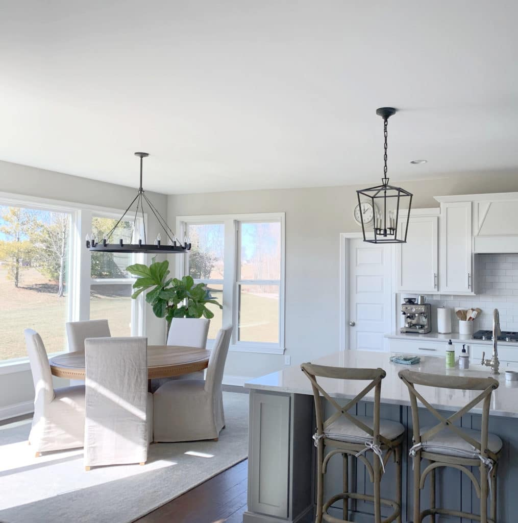 Kitchen and eating nook, white cabinets, grey island. Sherwin Williams Agreeable Gray. Kylie M Interiors Edesign, client before photo. Modern farmhouse, transitional s