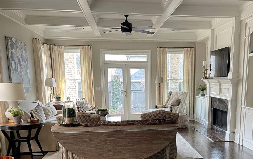 Living room with top beige paint color, Sherwin Williams Accessible Beige, wood floor, coffered ceilings. Kylie M Interiors Edesign, client photo
