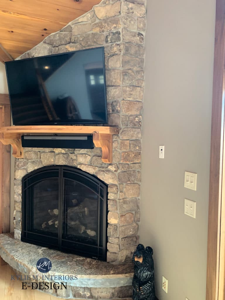 Sherwin Williams Tony Taupe, best beige paint color with stone fireplace and wood trim. Kylie M Interiors Edesign, diy advice blogger