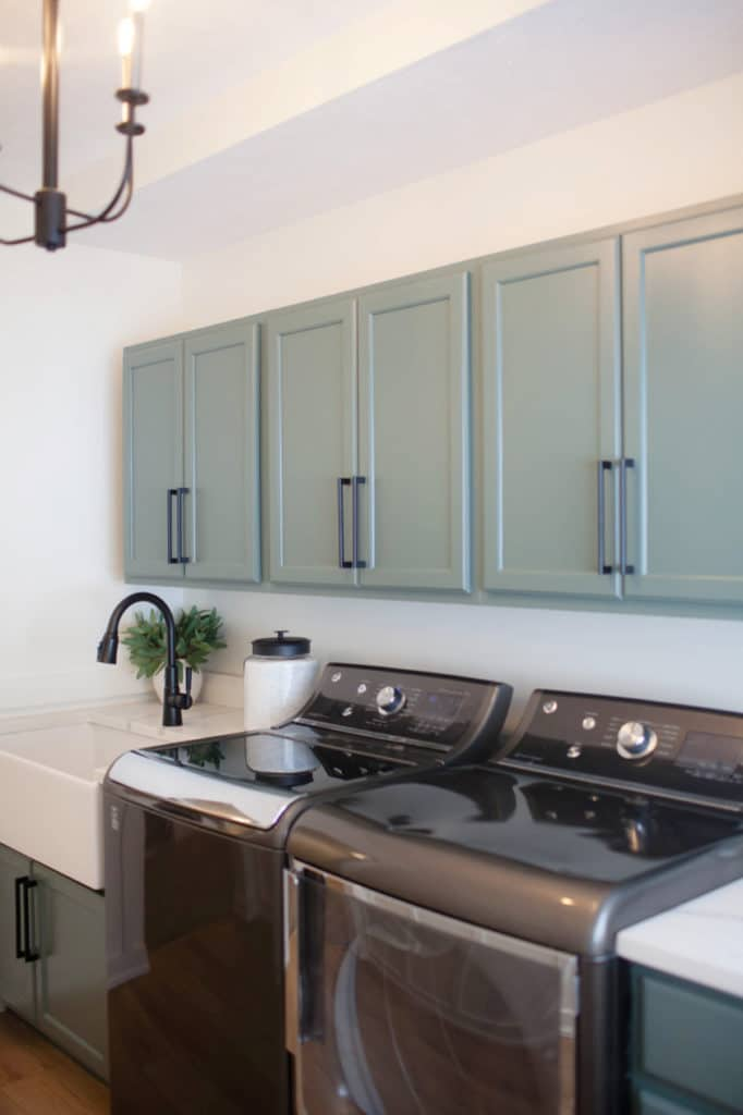 Benjamin Moore Caldwell Green cabinets. Washer and dryer and quartz, farmhouse sink. White Dove walls Kylie M Interiors Edesign, client photo. DIY UPDATE IDEAS