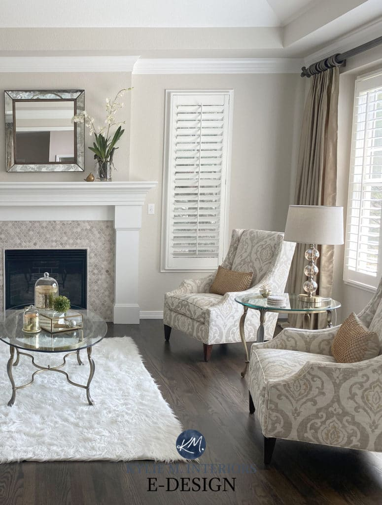 Accent chairs, dark wood floor in formal living room, travertine tile fireplace, white mantel. Edgecomb Gray, White Dove by Benjamin Moore. Kylie M Edesign, consultant and diy expert