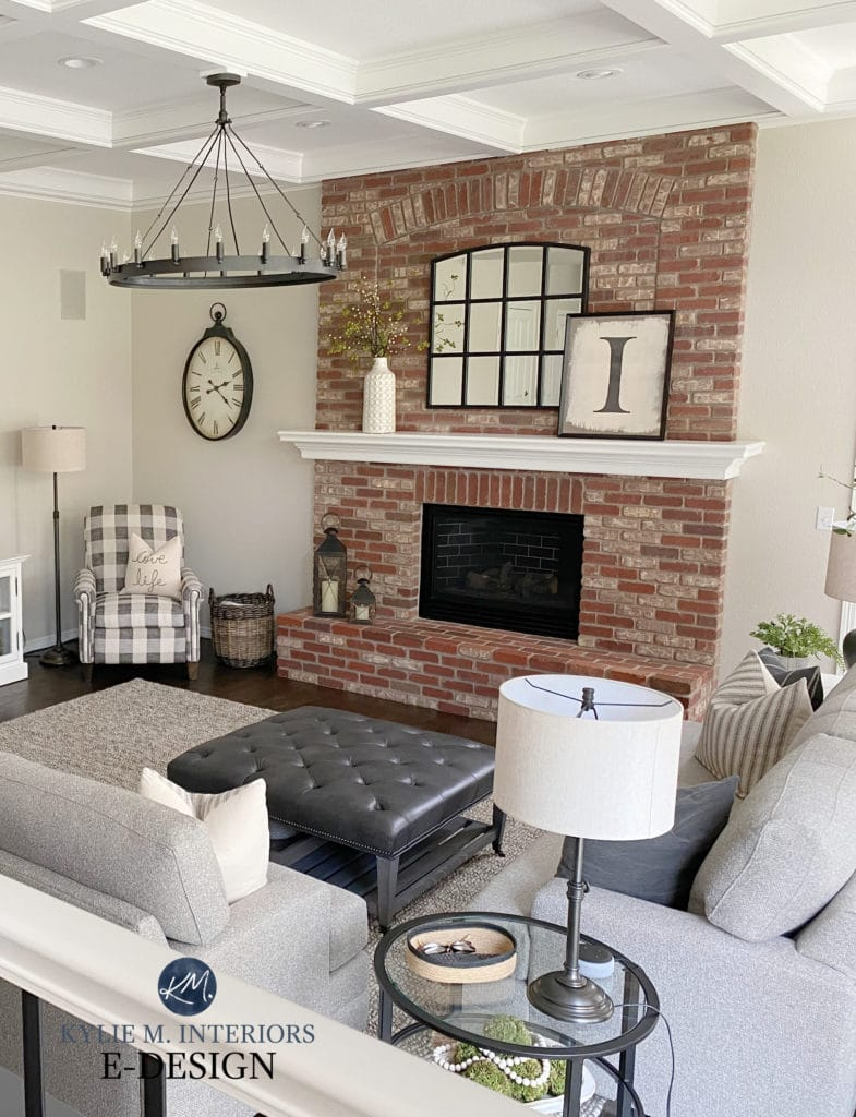 Family room, brick fireplace that's pink with greige walls, transitional style home decor, chandelier, white trim. Kylie M Interiors Edesign, diy decorating blogger
