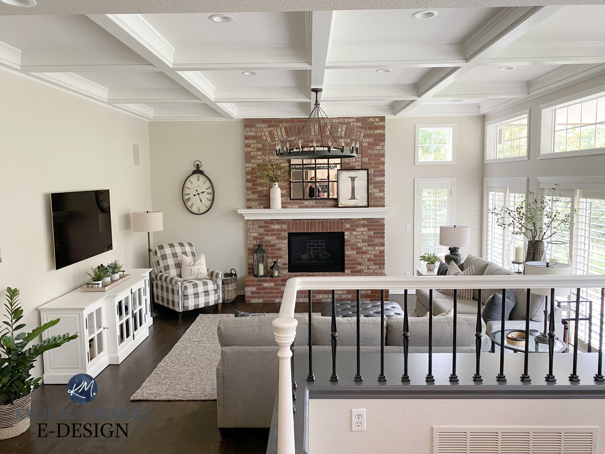 Split-level family room with transitional style home decor and furniture. Red, pink brick fireplace and greige walls, white trim. Kylie M Interiors Edesign. Benjamin Edgecomb, White