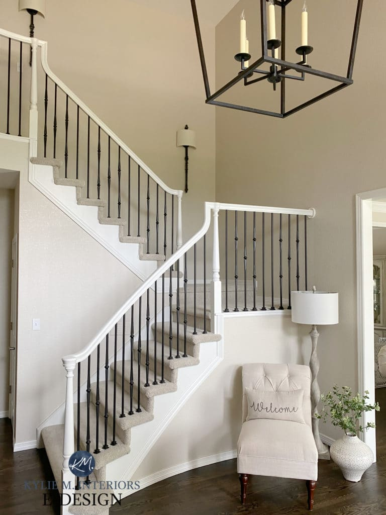 Staircase, painted wood hand railing, painted metal spindles, beige or tan carpet and greige walls. Kylie M Interiors Edesign. diy update ideas for the home. Dark wood floor