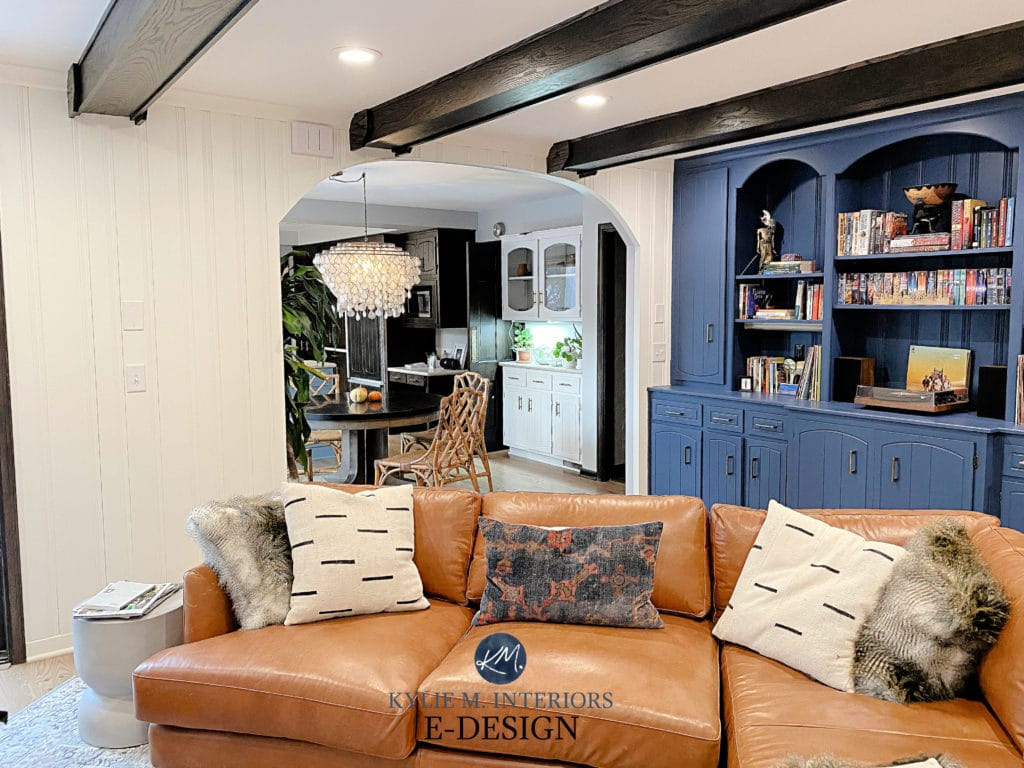 Van Deusen Blue painted built-in bookcase and Simply White. Dark wood beams, tobacco cognac leather sofa. Kylie M Interiors Edesign, diy advice, client phot
