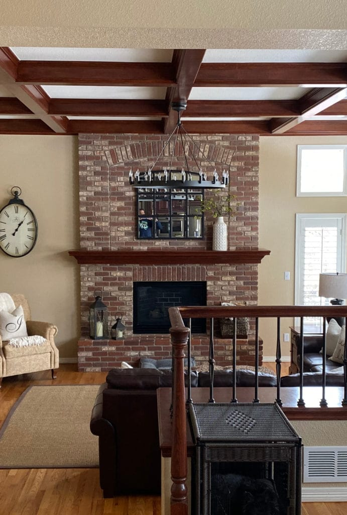 family room before, brick fireplace