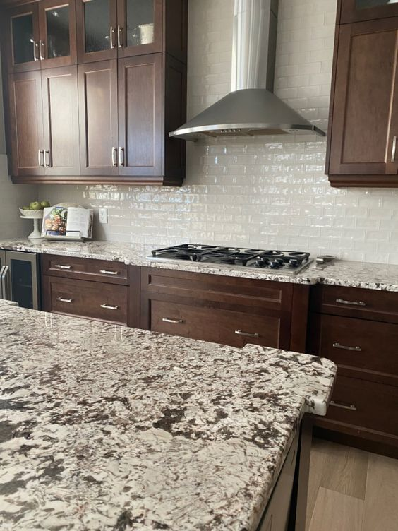Dark wood kitchen before cabinets painted with granite (4)