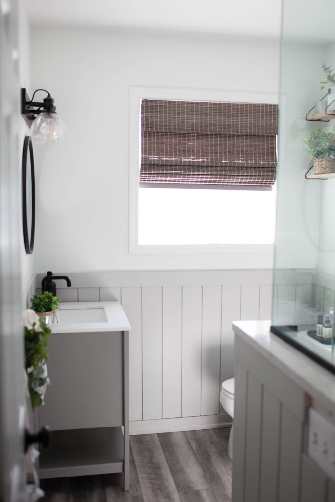 Sherwin Williams Pure White and Light French Gray board and batten beadboard, small bathroom ideas, gray vanity. Kylie M Interiors Edesign, diy updates