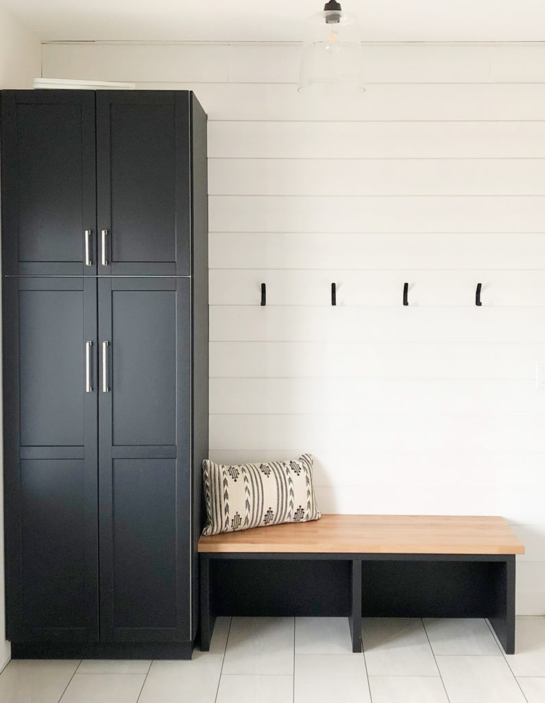 How to choose best white paint colour. Benjamin Moore Glacier White, black built-in bench entryway storage. Kylie M Interiors client photo